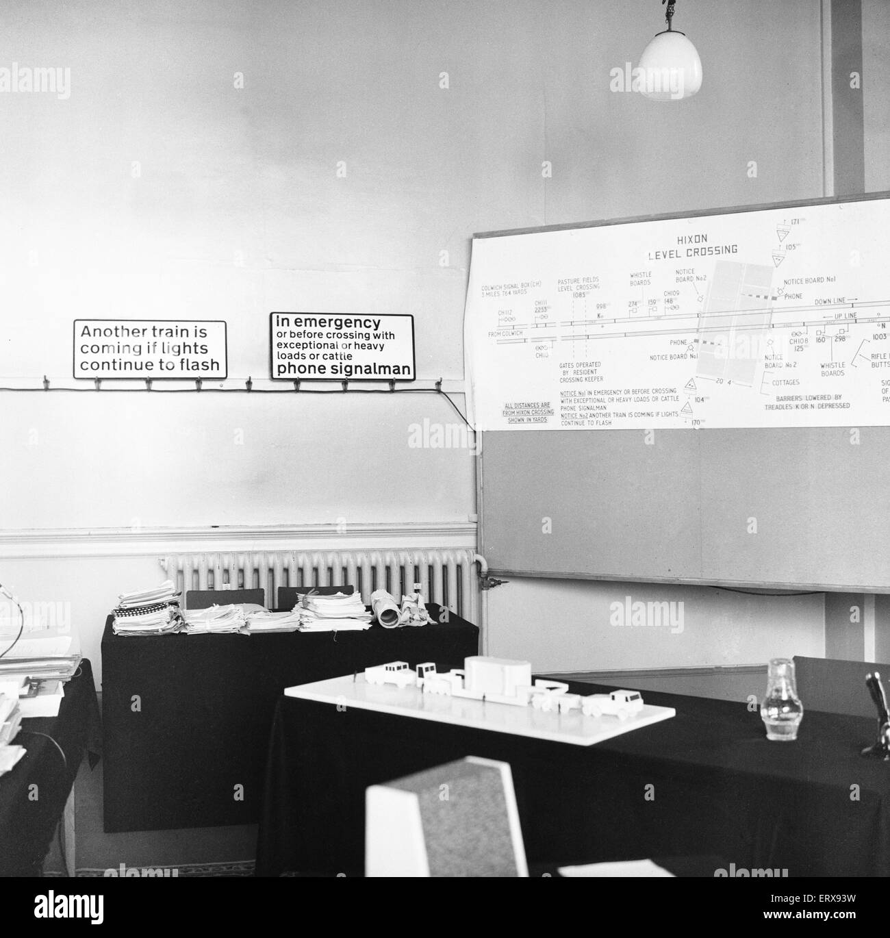 Model showing the transformer transport as it crossed the Hixon level crossing and diagram on the wall of the court - Stock Image