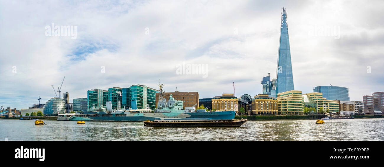 The Shard, HMS Belfast, City Hall and Tidy Thames barge on River Thames, London, UK. - Stock Image