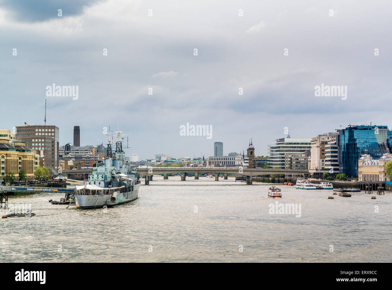 River Thames with HMS Belfast, London Bridge and Northern and Shell building, London, UK. - Stock Image