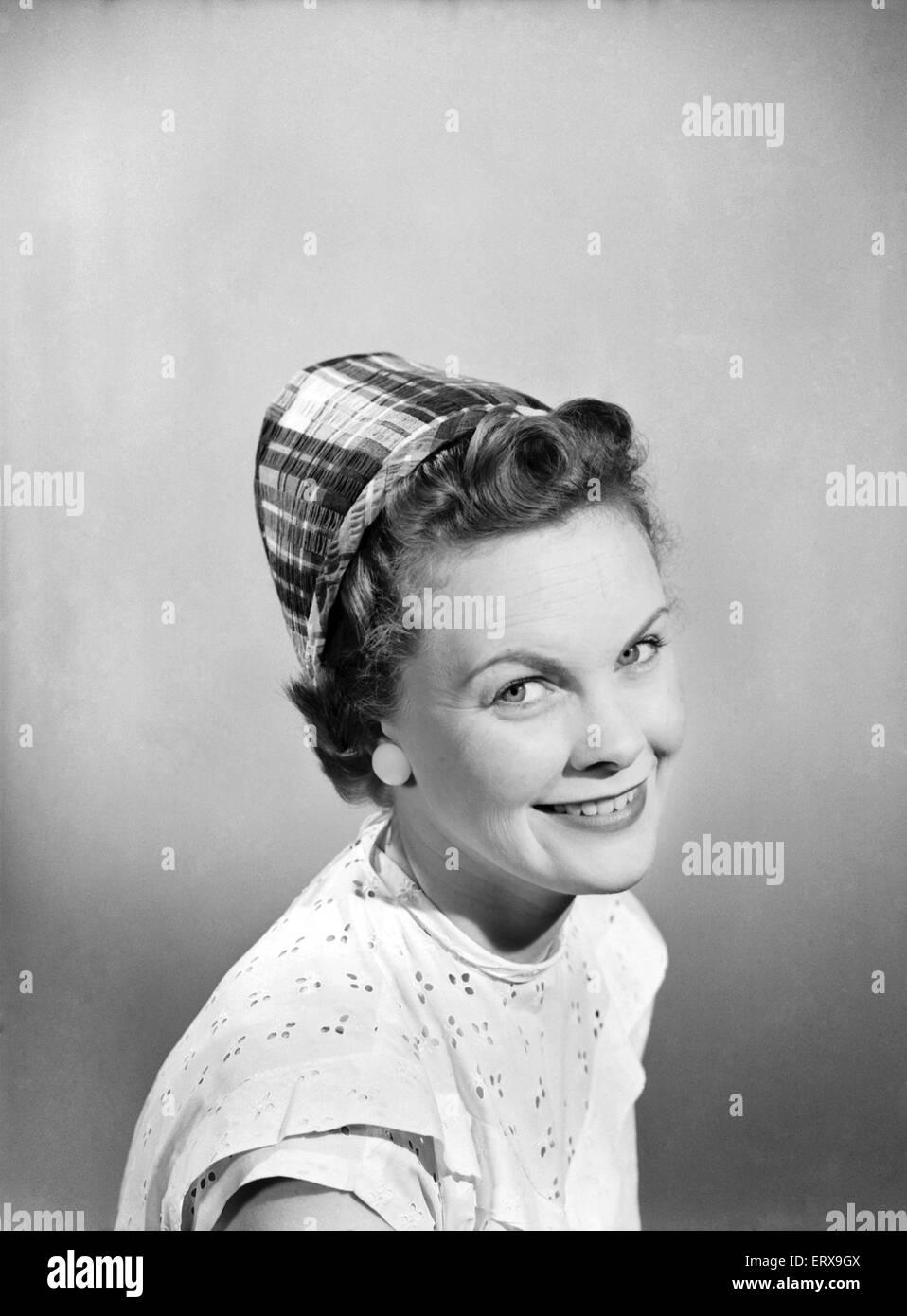Women's clothing, fashion, hats. 1955 - Stock Image