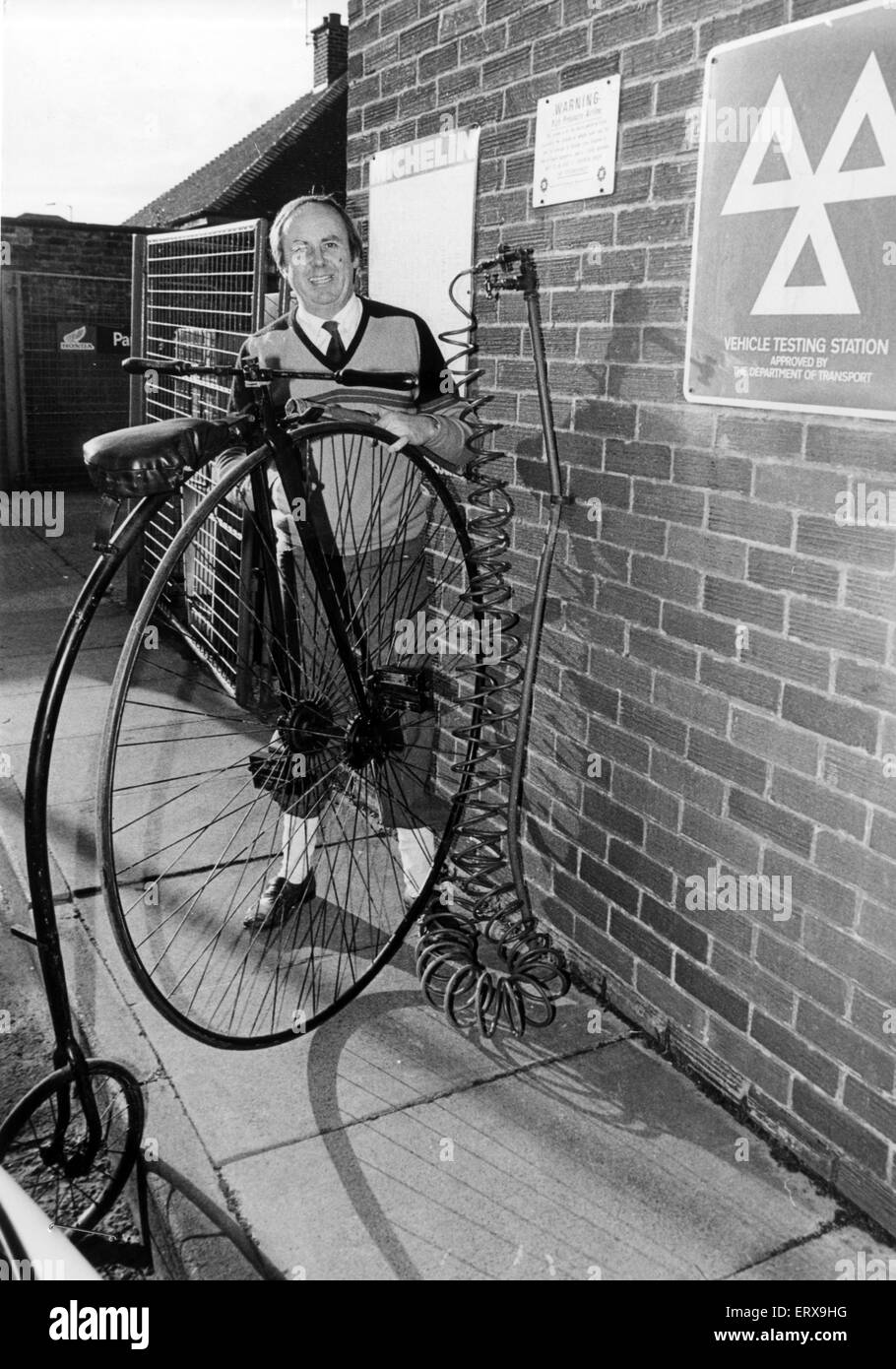 Salesman, John Whitfield, pictured with his 19th Century Penny Farthing Cycle, which is for sale, priced at £500. - Stock Image