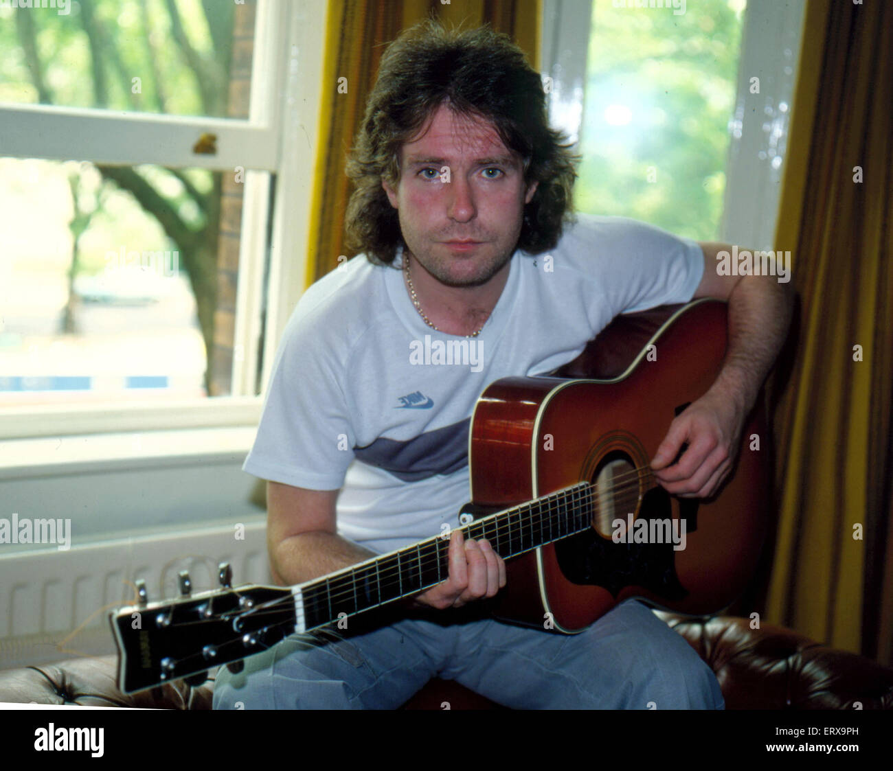 Frankie Miller with his guitar. November 1981. - Stock Image