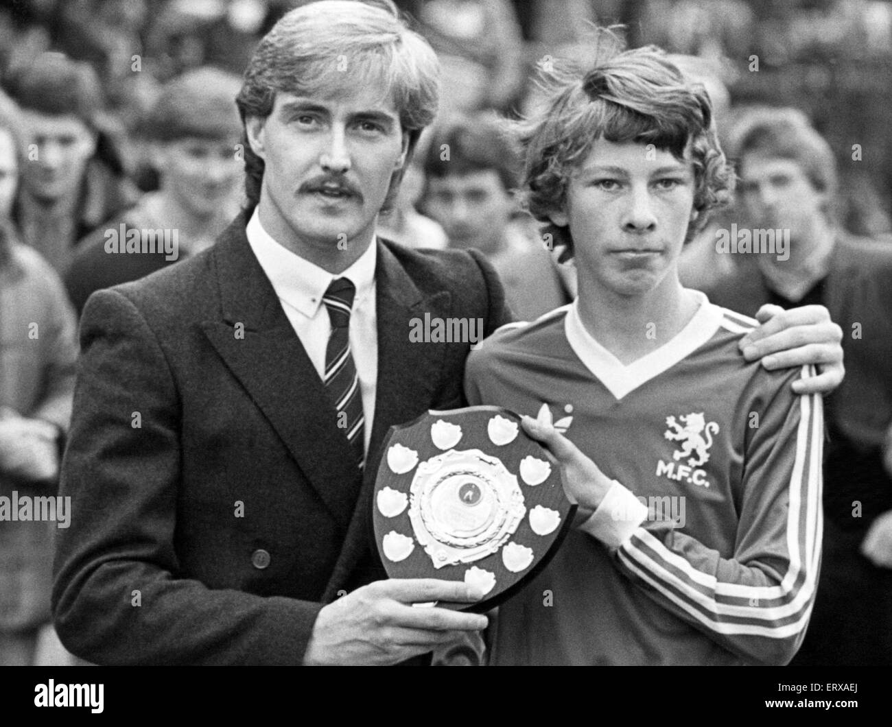David Hodgson the Boro Junior Reds' pin-up receives their player of the Year award from Mark Nasseu, 2nd May - Stock Image