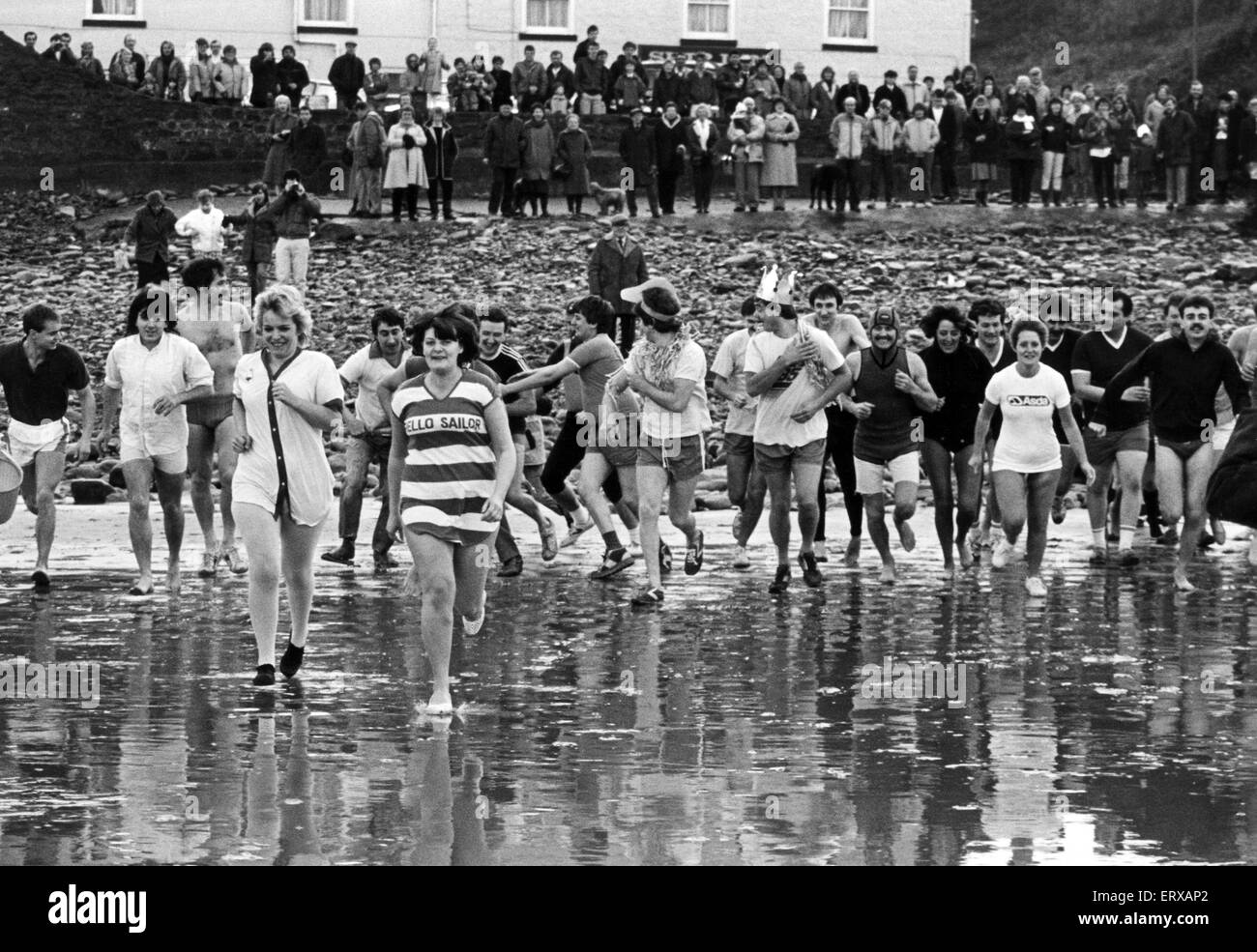 Over 50 regulars of The Ship Inn, Saltburn, took part in the New Years Day swim in the North Sea and raised ¿1,180 - Stock Image