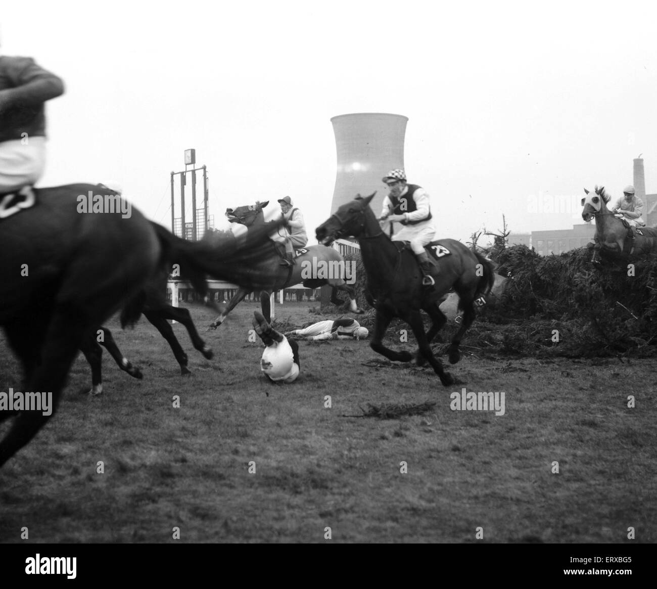 Jockey Paddy Farrell is thrown from his horse Border Flight at the 15th fence of the Aintree Grand National.  Farrell - Stock Image