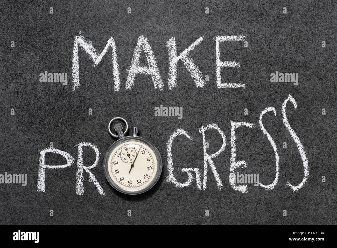 make progress phrase handwritten on chalkboard with vintage precise stopwatch used instead of O - Stock Image