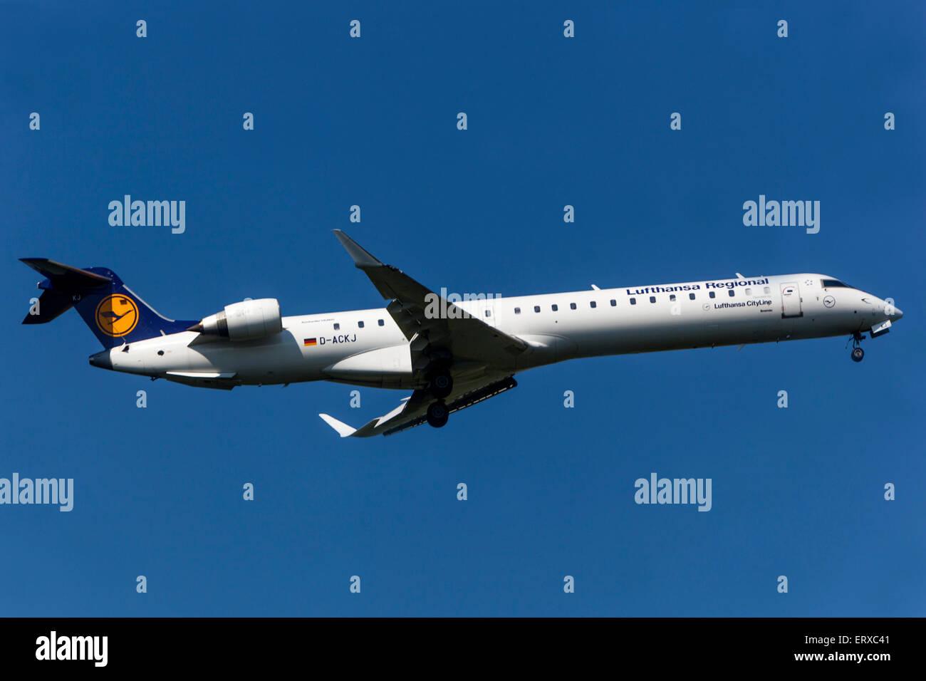 Canadair CRJ-900 operated by Lufthansa CityLine on approach for landing Prague, Czech Republic - Stock Image