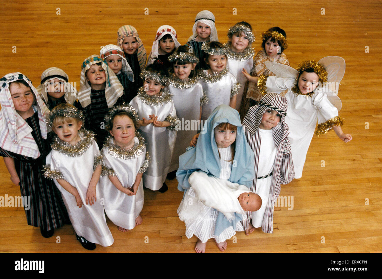 Mary and Joseph, Hannah Thompson (4) and Jamie Rozario (5) with the Angel Sarah Beaver (4) and pupils from St Joseph's - Stock Image