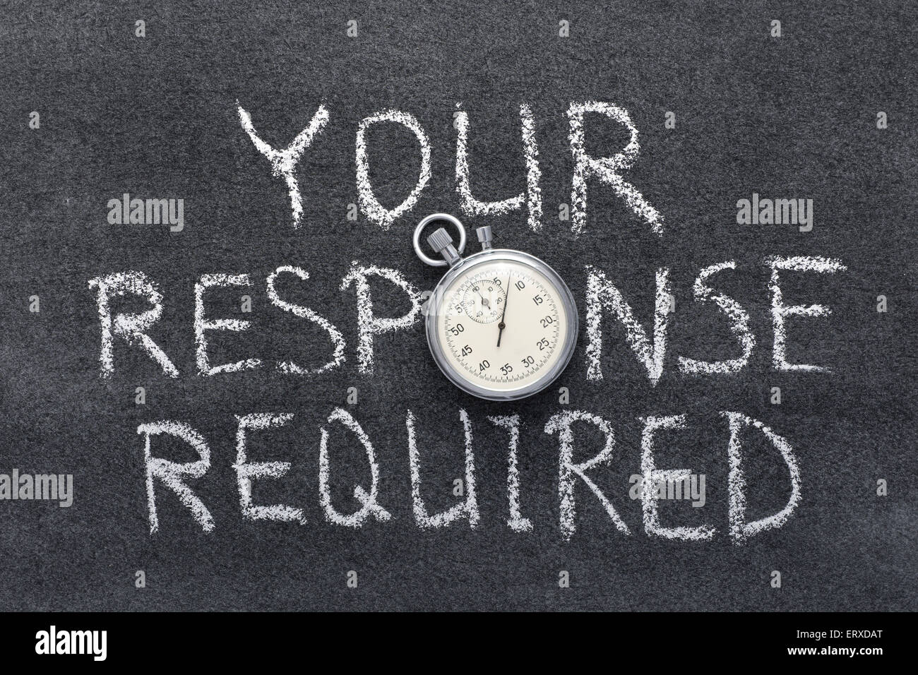 your response required phrase handwritten on chalkboard with vintage precise stopwatch used instead of O - Stock Image