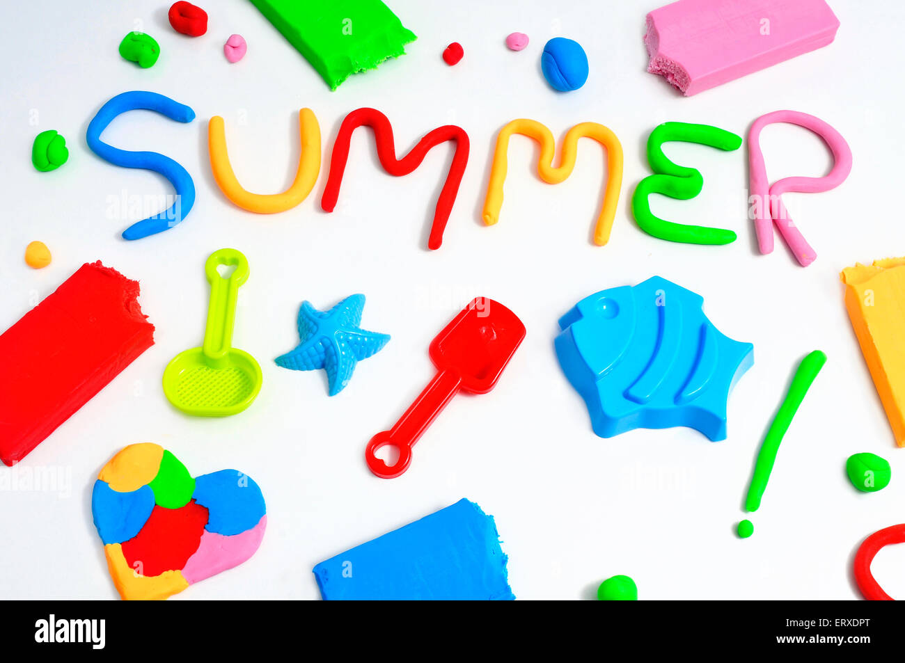 the text summer made from modelling clay of different colors and some beach toys such as toy shovels and sand moulds, - Stock Image