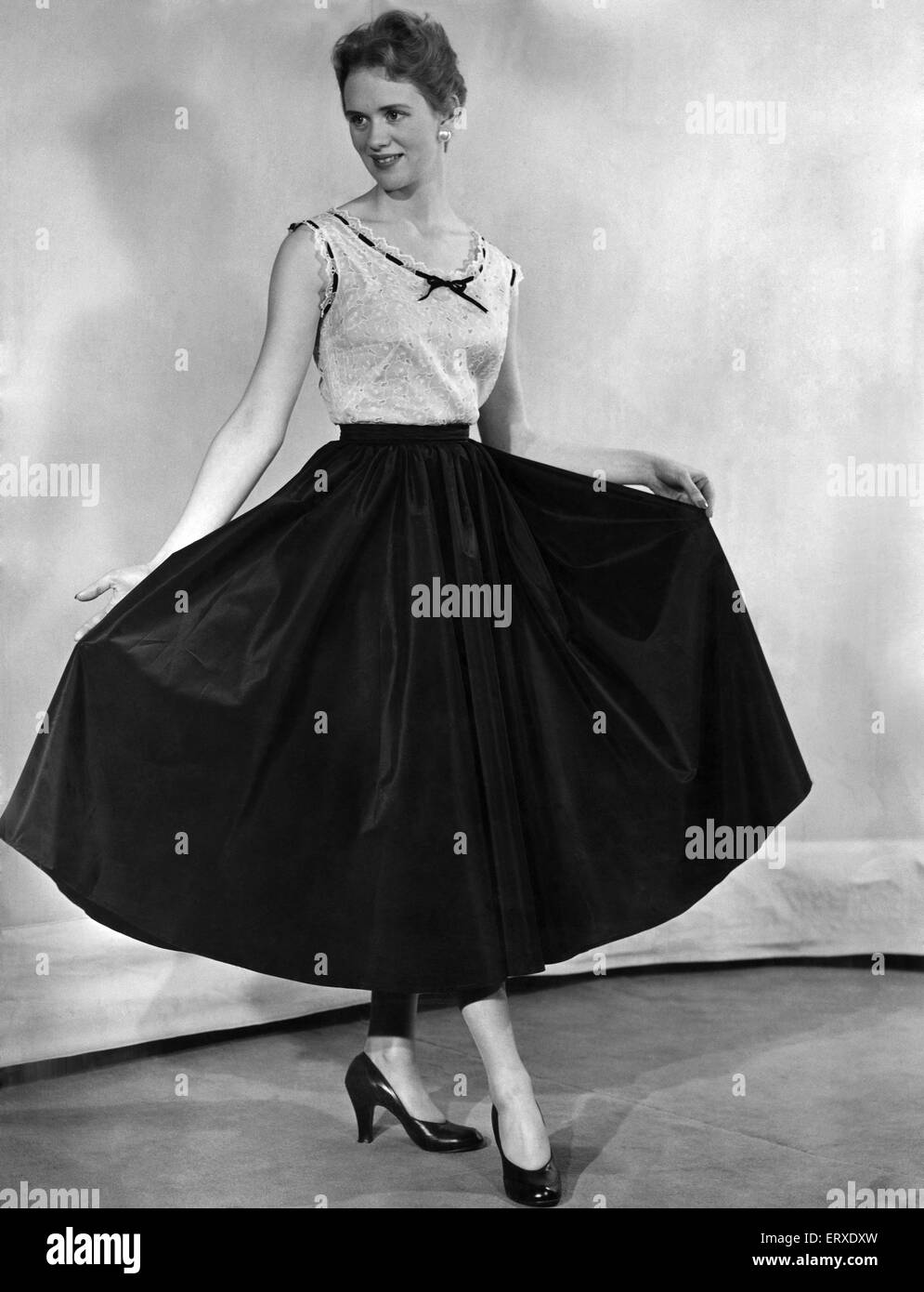 A fashion photograph from December 1953. - Stock Image