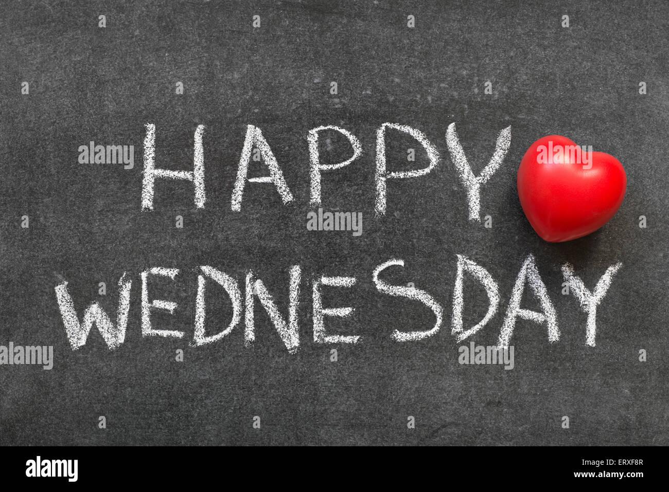 Happy Wednesday Phrase Handwritten On Blackboard With Heart Symbol