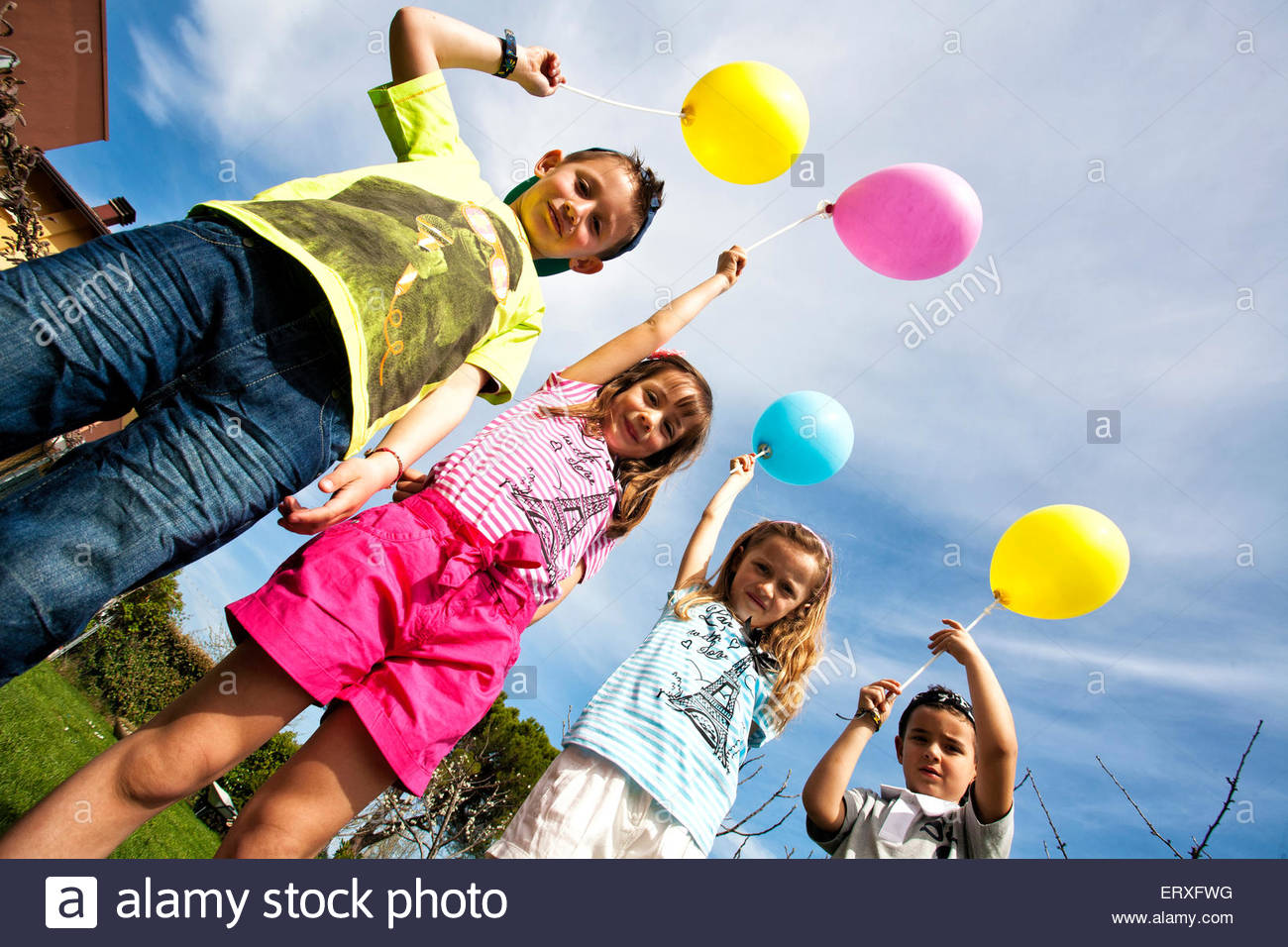 children with multi coloured balloon - Stock Image