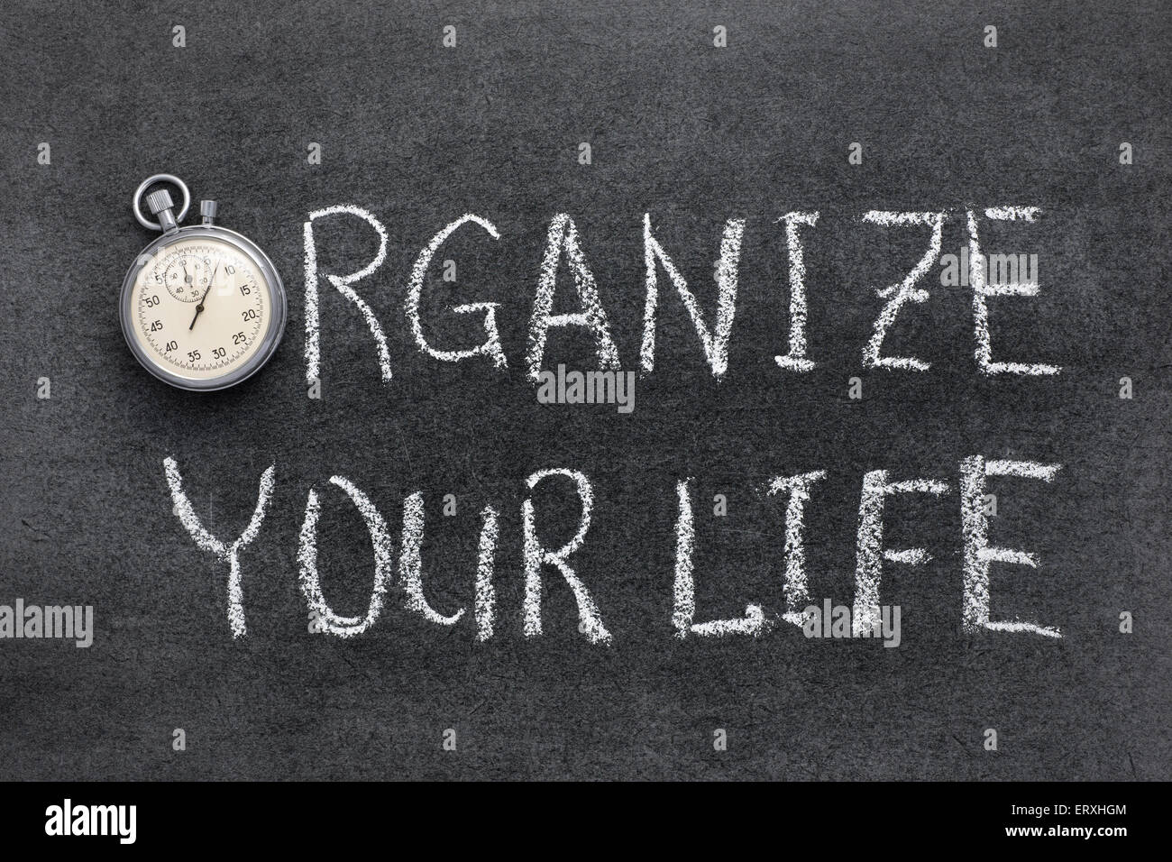 organize your life phrase handwritten on chalkboard with vintage precise stopwatch used instead of O - Stock Image