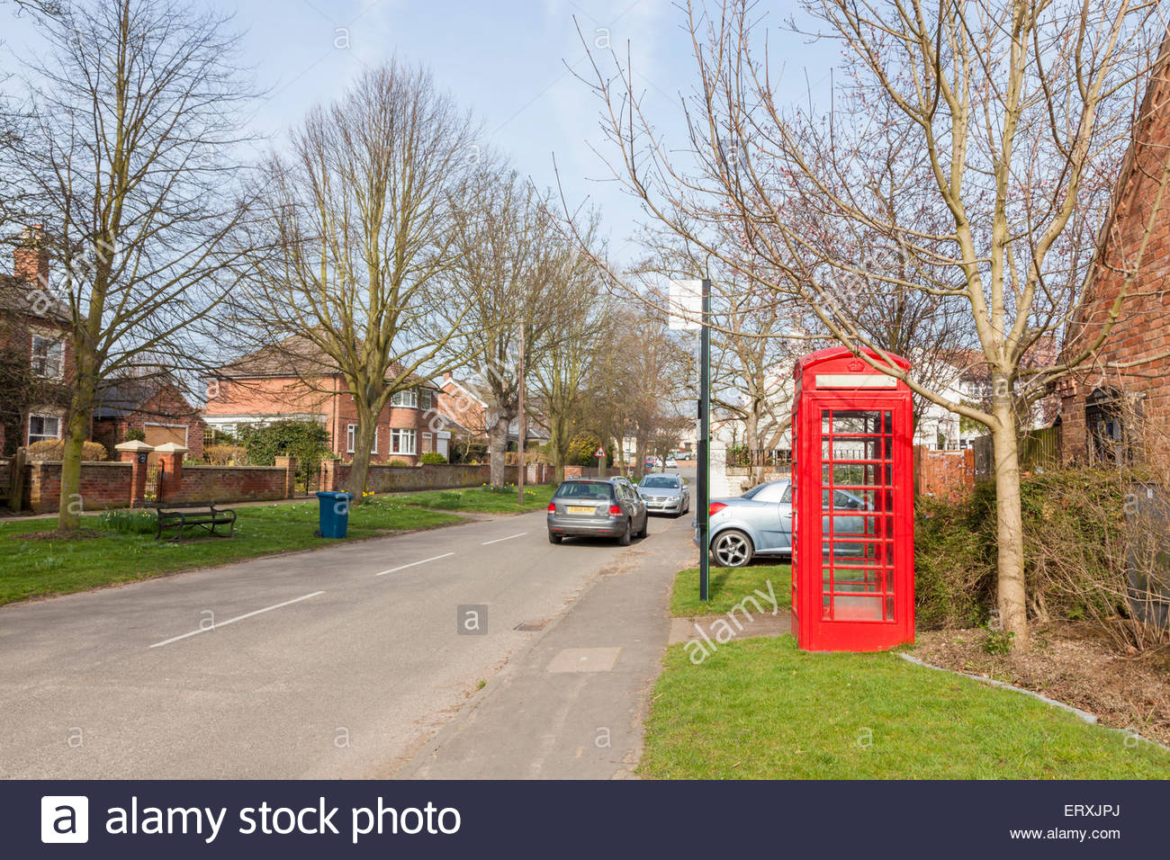 Red telephone box on a village street, Wysall, Nottinghamshire, England, UK - Stock Image