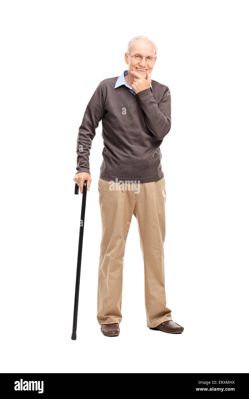 Full length portrait of a casual senior with a black wooden cane posing isolated on white background Stock Photo