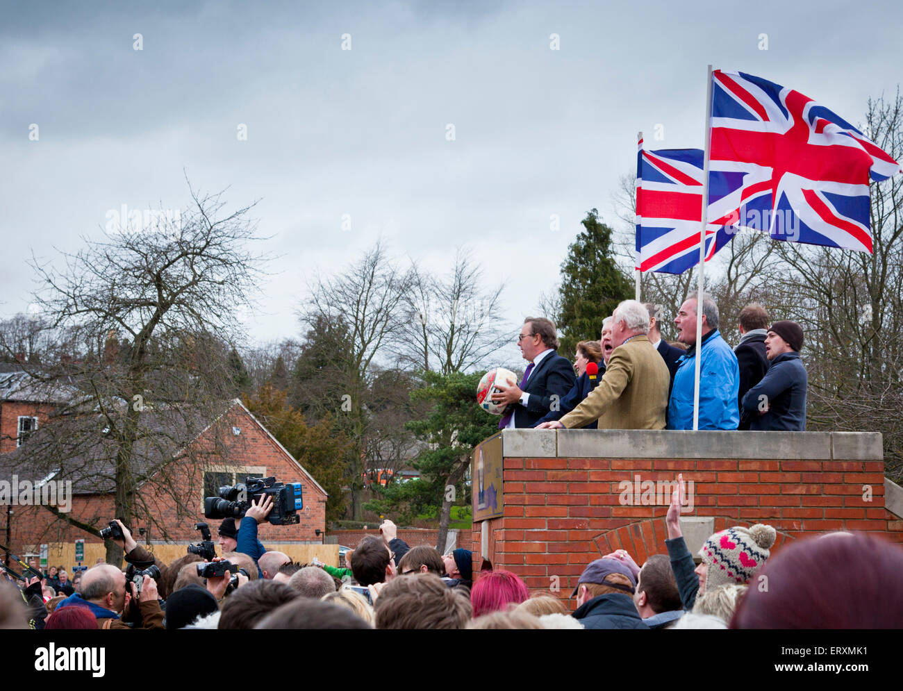 Local man throwing the ball to start  the Royal Shrovetide Football Match, Ashbourne, Derbyshire, England UK GB - Stock Image