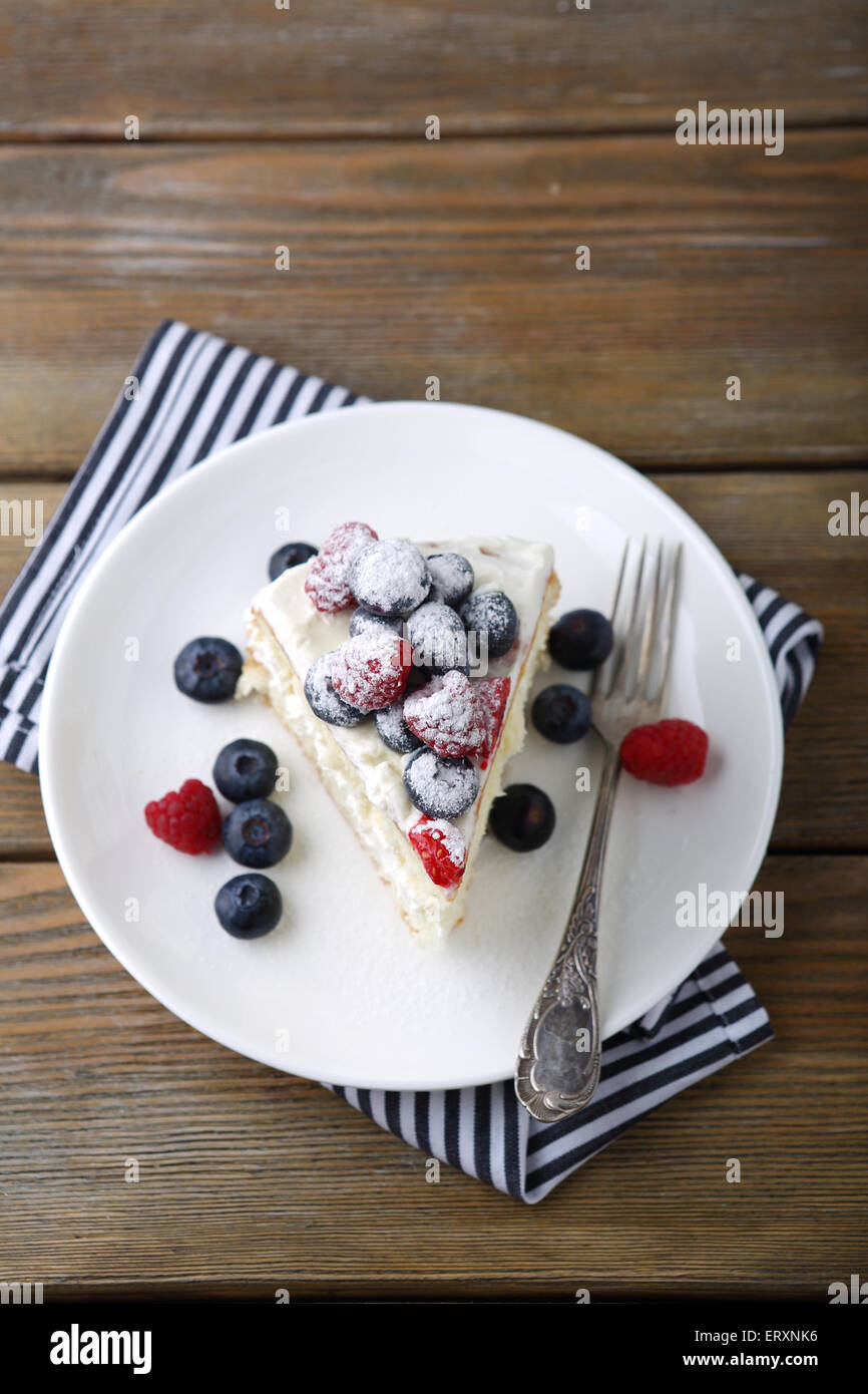 Cake with blueberries and raspberries, top view - Stock Image