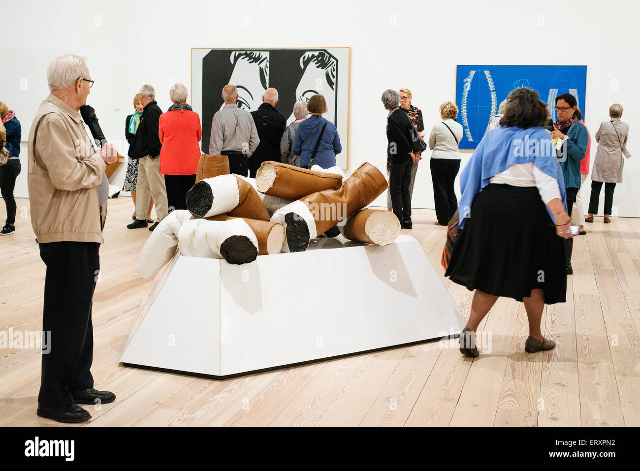 A visitor checking out the Claes Oldenburg installation 'Giant Fagends' in the new Whitney Museum in lower - Stock Image