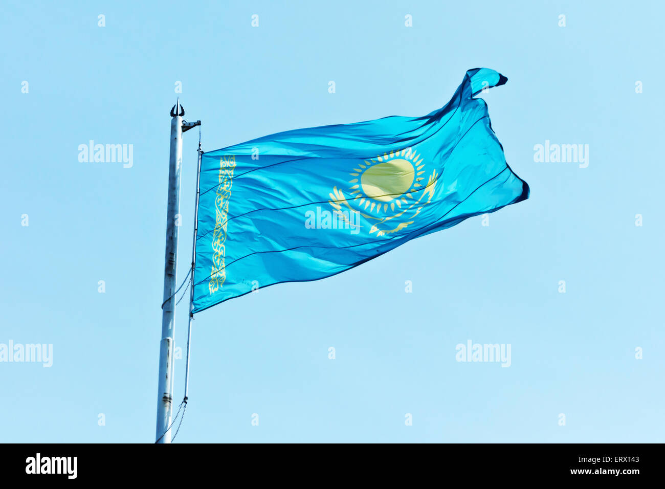flag Kazakhstan against blue sky - Stock Image