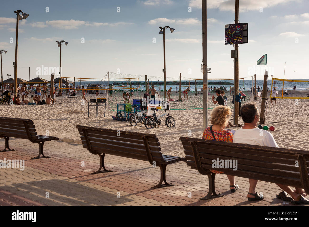 people sitting along Tel Aviv seafront , Israel - Stock Image