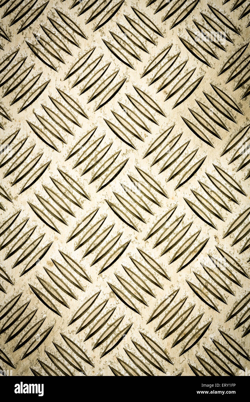 Gold colored diamond plate, checker plate, tread plate, cross hatch kick plate and Durbar floor plate for texture - Stock Image