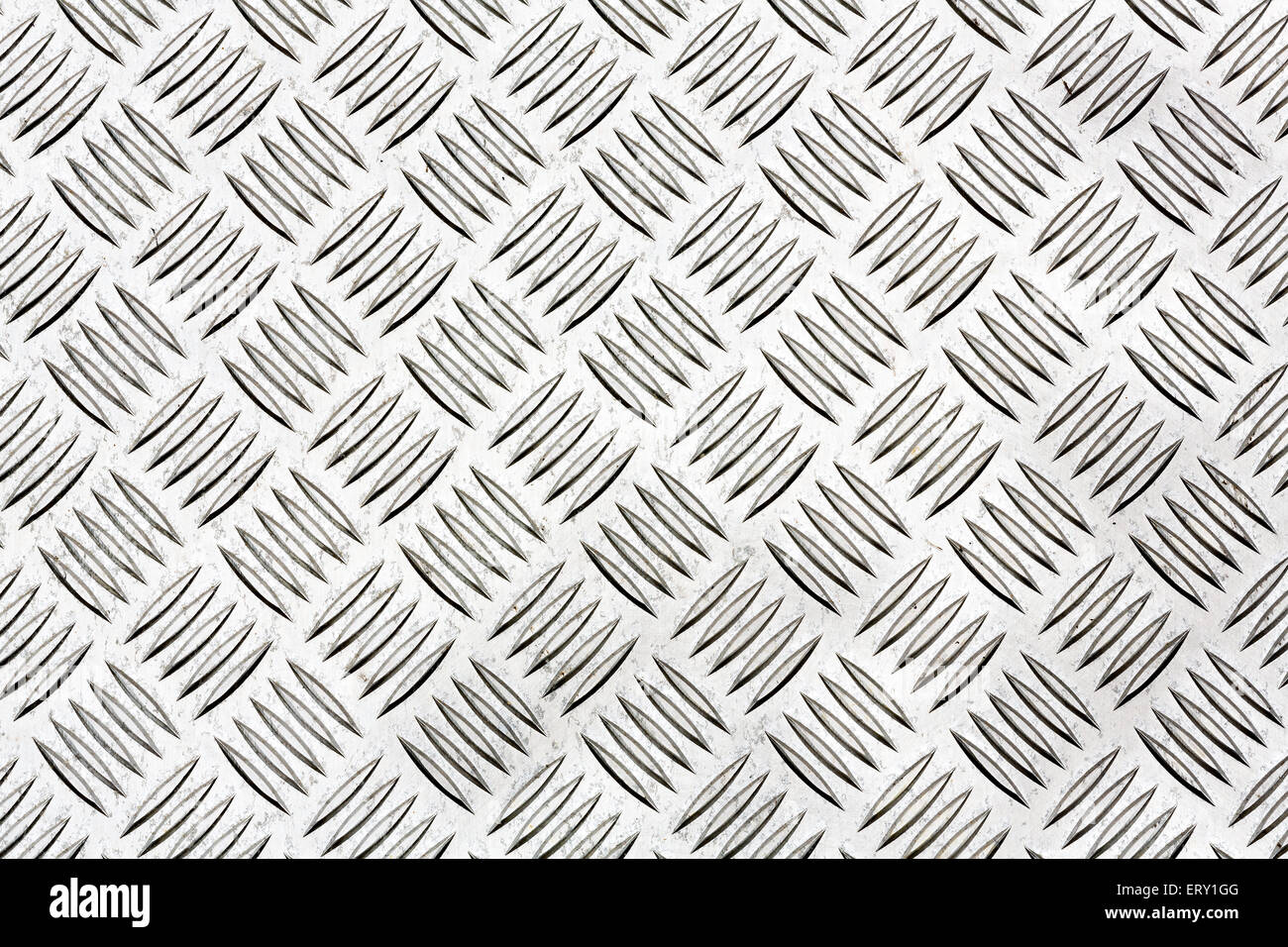 Diamond plate, also known as checker plate, tread plate, cross hatch kick plate and Durbar floor plate for texture - Stock Image