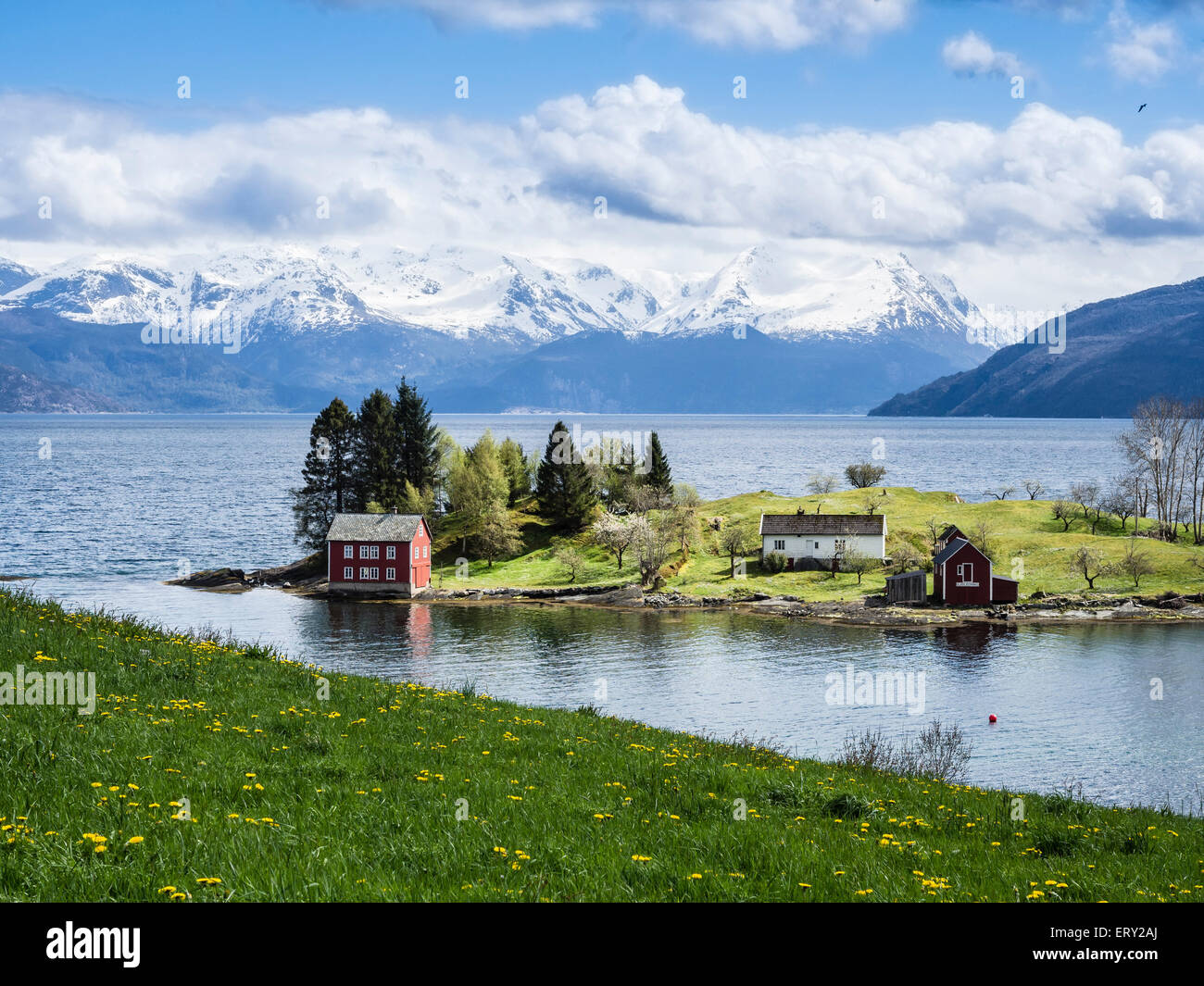 Typical red house on an island in the Hardangerfjord, near Strandebarm, Hordaland, Norway - Stock Image