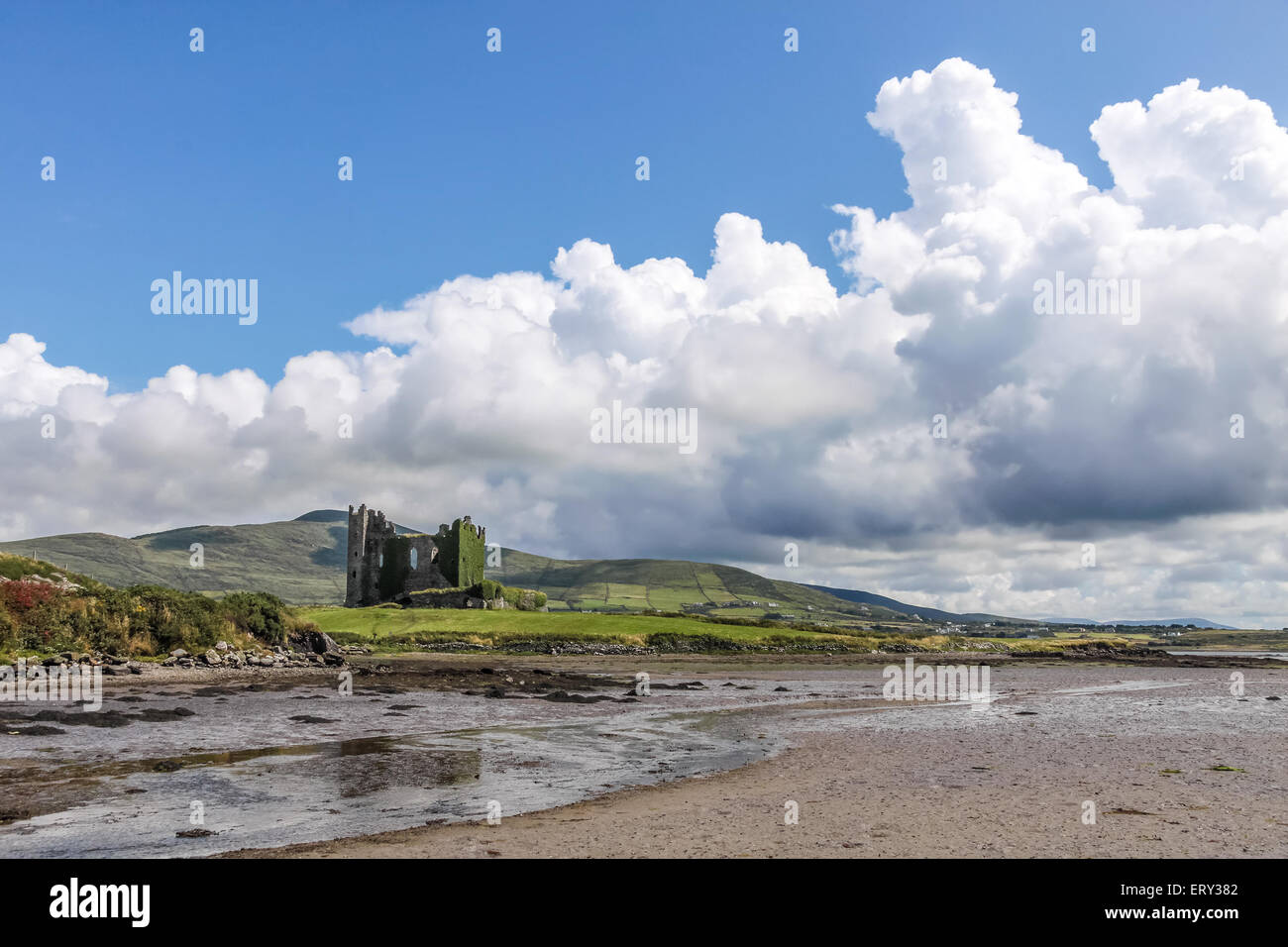 Ballycarbery Castle with giant clouds at the Ring of Kerry in Cahersiveen, County Kerry, Ireland - Stock Image