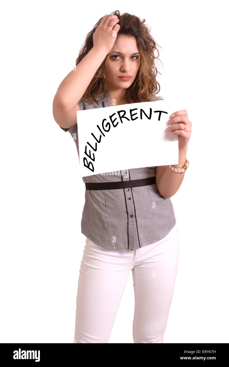 Young attractive woman holding paper with Belligerent text on white background - Stock Image