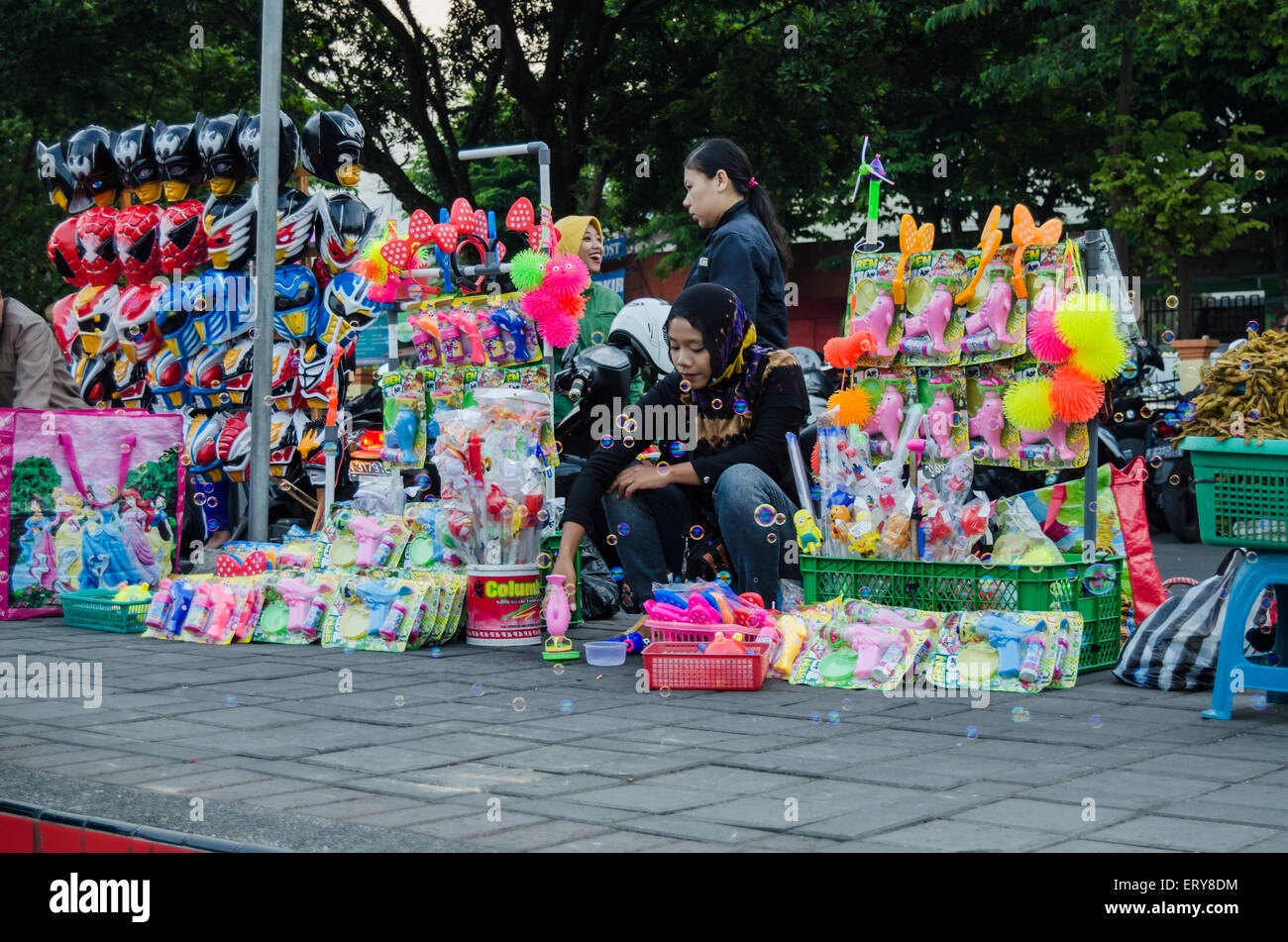toy seller in the pavement - Stock Image