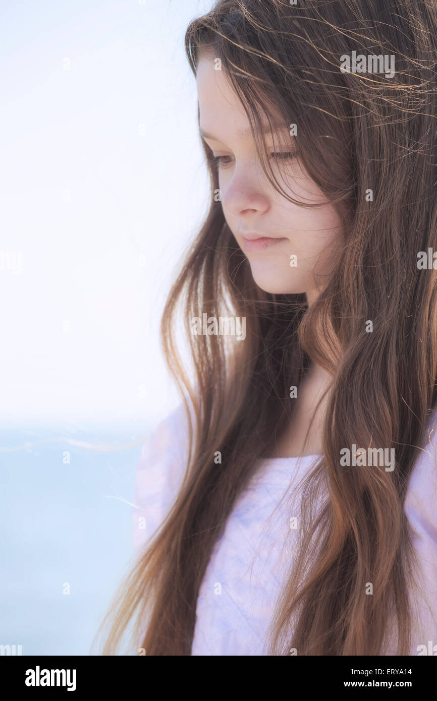 portrait of a pensive young teenage girl - Stock Image