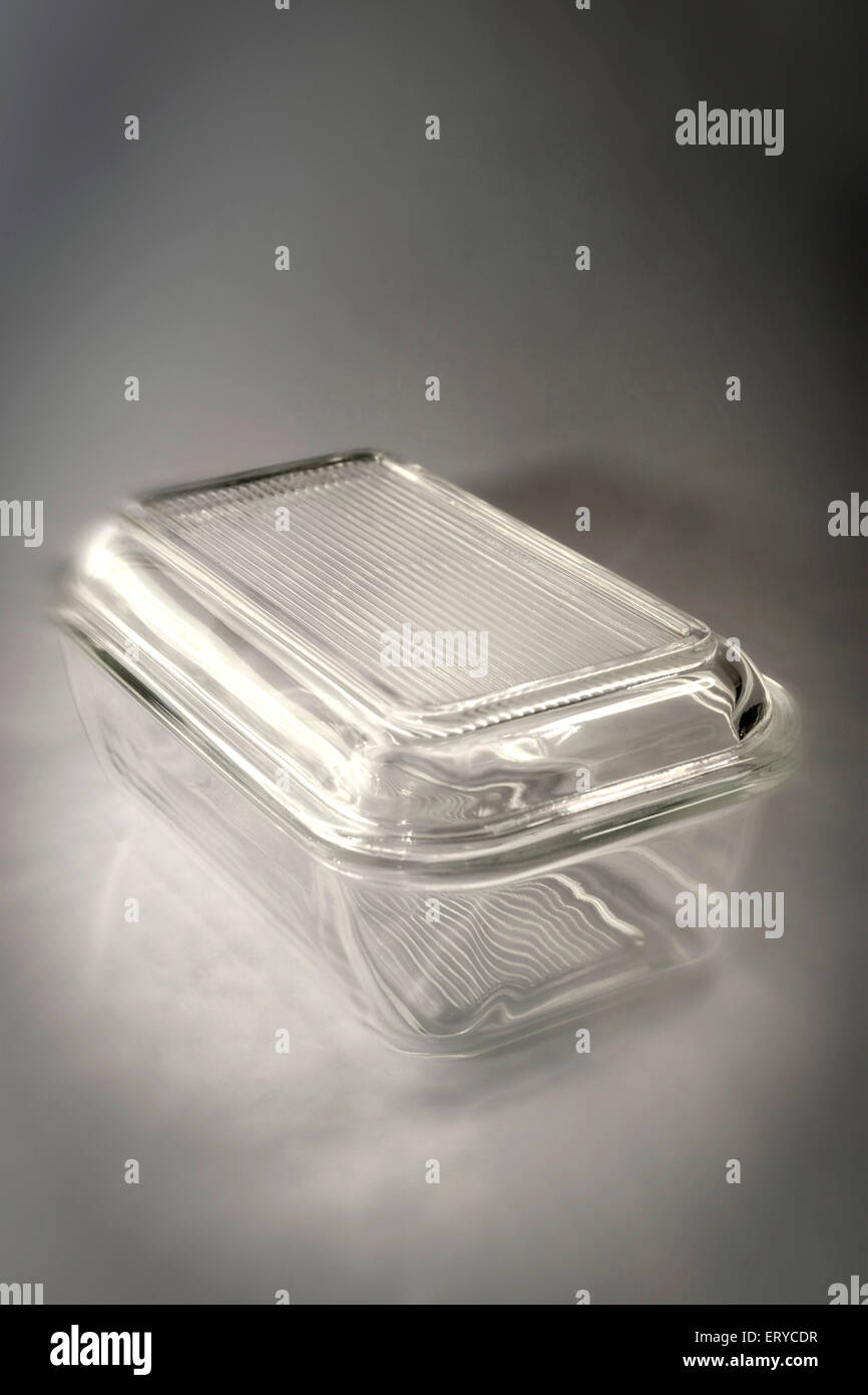 Kitchen thing ; glass butter box on gray background - Stock Image