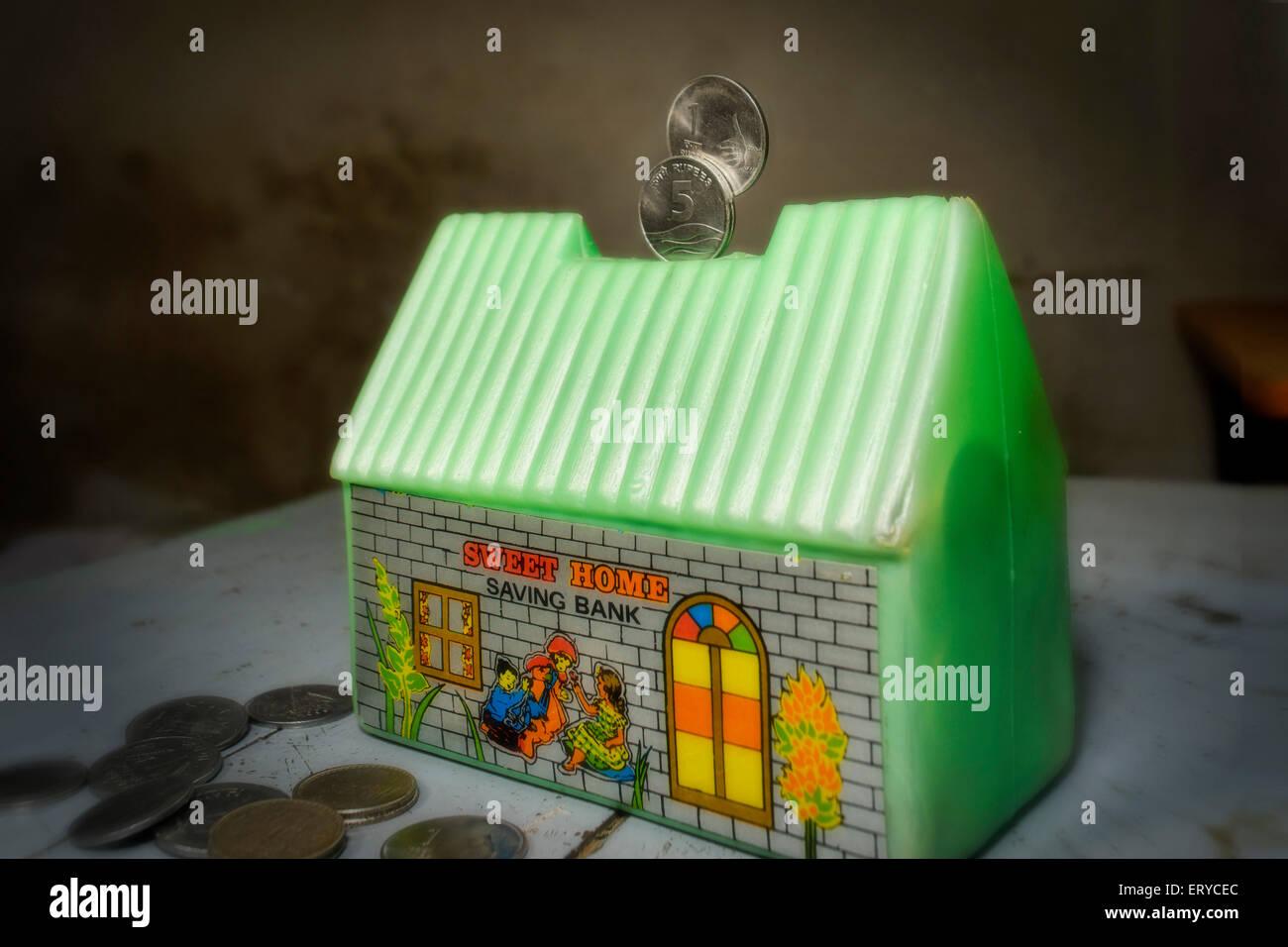 Concept ; money saving home ; saving bank ; India - Stock Image