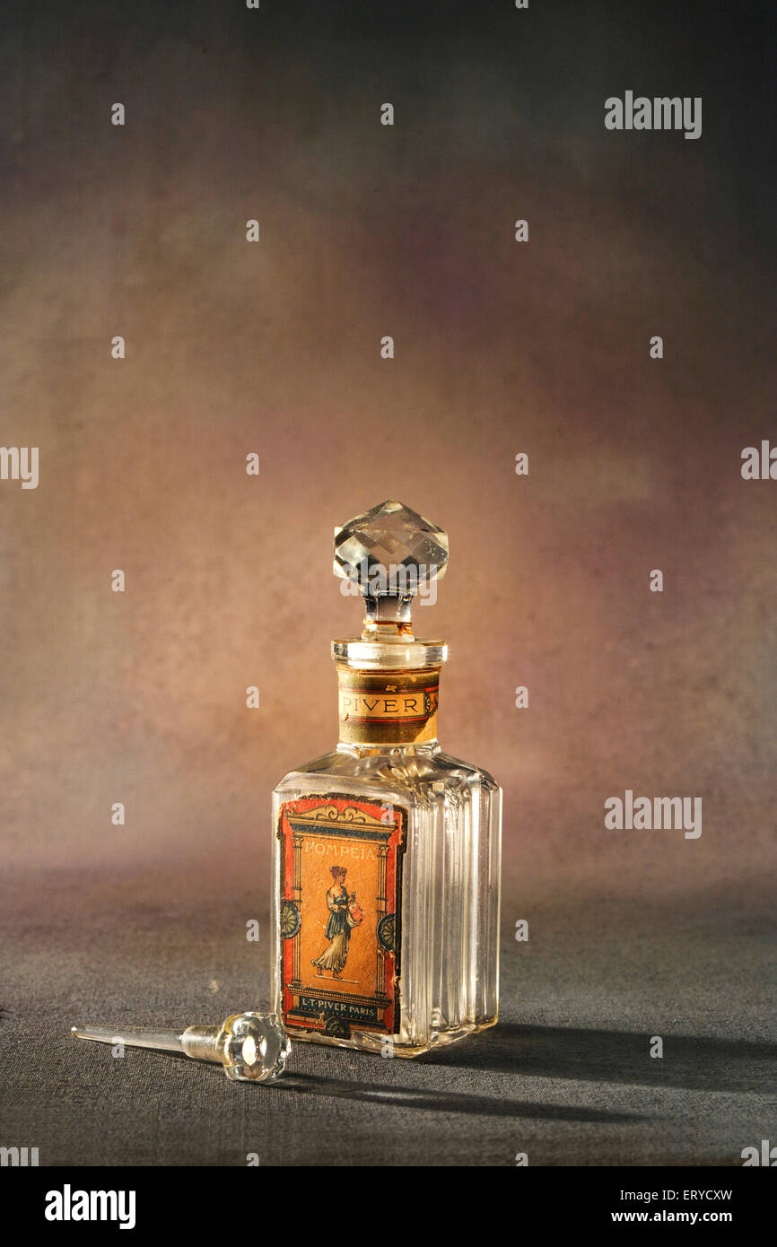 Old vintage perfume glass bottle - Stock Image