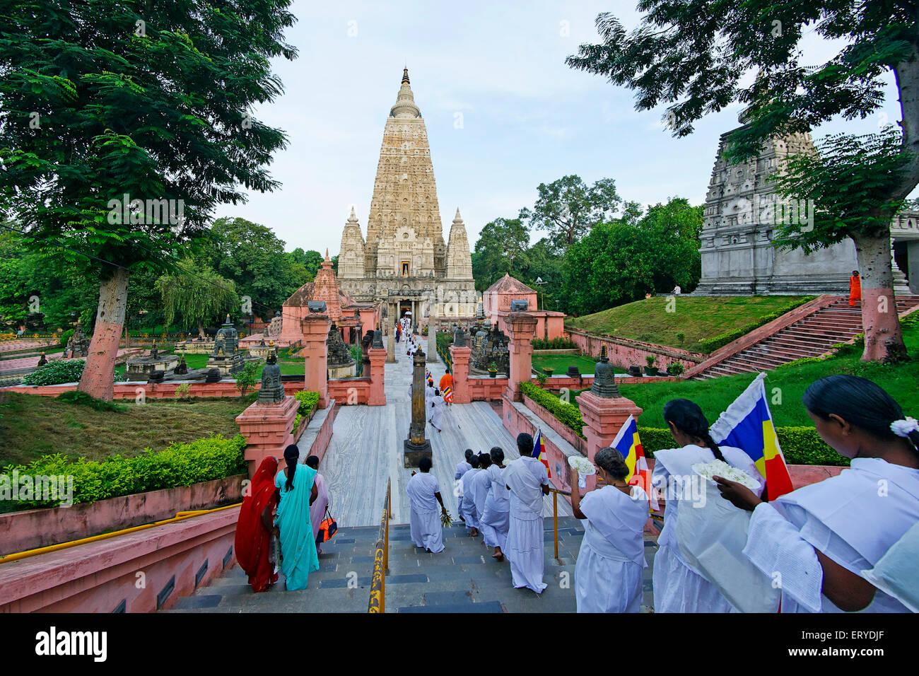 Pilgrims of Sri Lankan at rituals ; UNESCO World Heritage site Mahabodhi temple ; Bodhgaya ; Bihar ; India - Stock Image