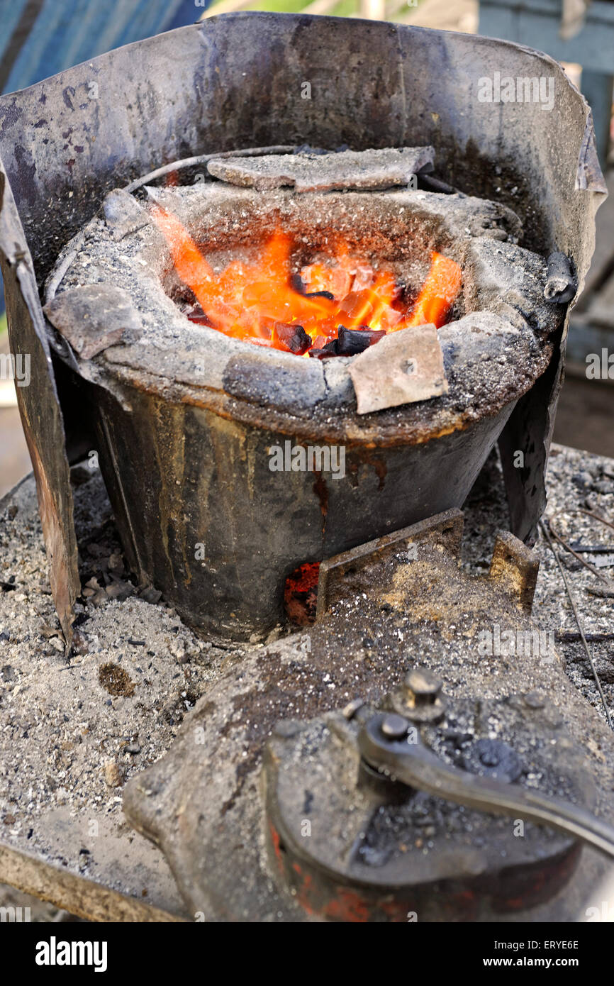 Charcoal burning for tea ; district Bhavnagar ; Gujarat ; India - Stock Image