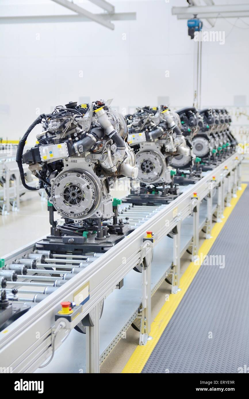 Newly manufactured engine on the production line in a factory. - Stock Image