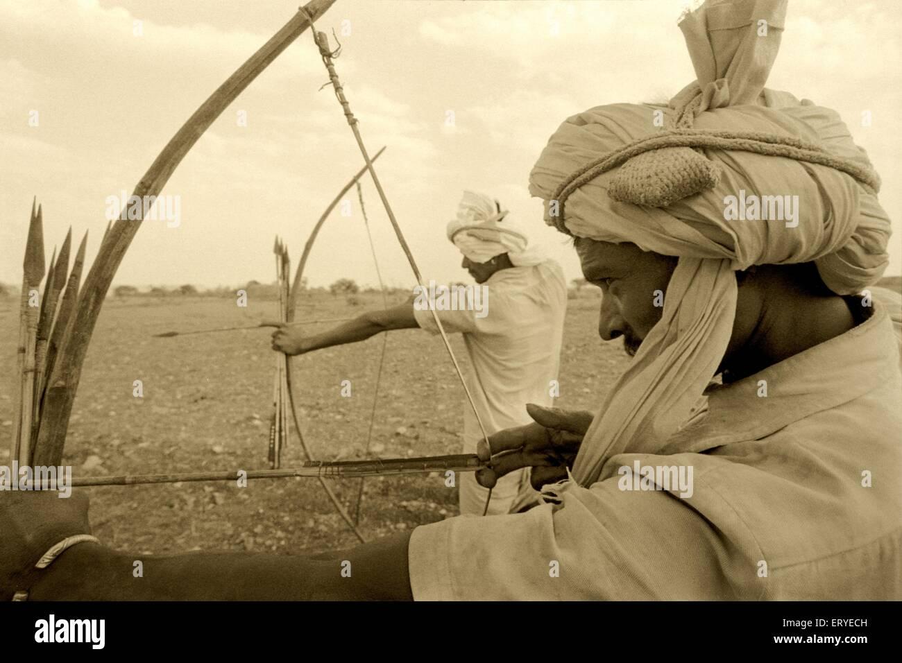Zabua tribe with bow arrow ; Madhya Pradesh ; India - Stock Image