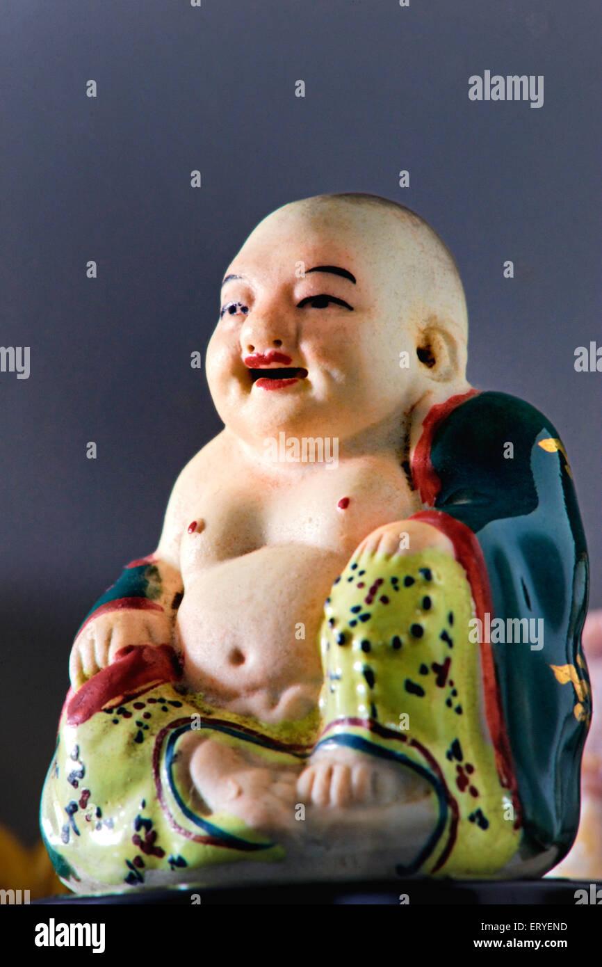 Faith ; Laughing Buddha - Stock Image