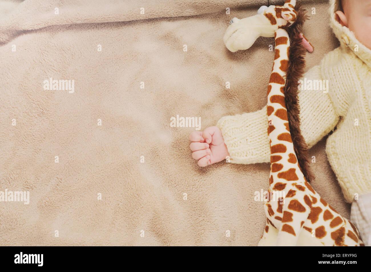 sleeping cute newborn baby, maternity concept, soft image of beautiful family - Stock Image