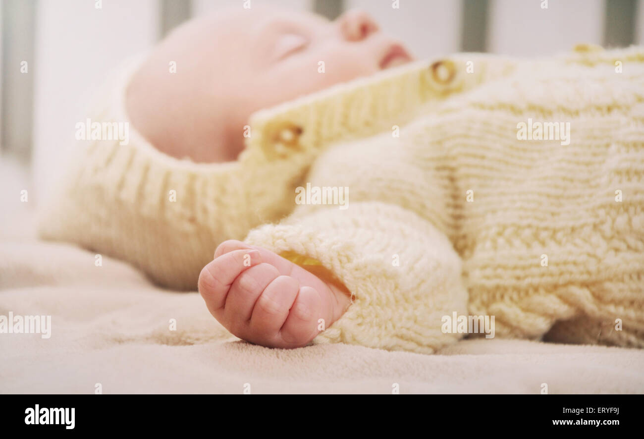 Sleeping cute newborn baby maternity concept soft image of beautiful family