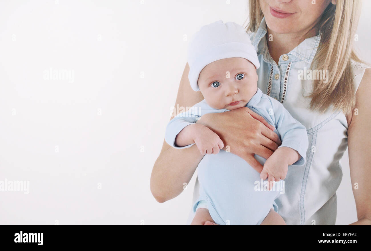 mother and her newborn baby, maternity concept, soft image of beautiful family - Stock Image