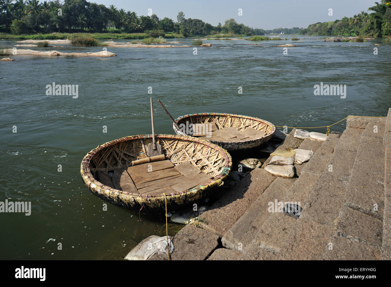 Coracles at riverbank of kaveri ; Srirangapatna ; Mysore ; Karnataka ; India - Stock Image