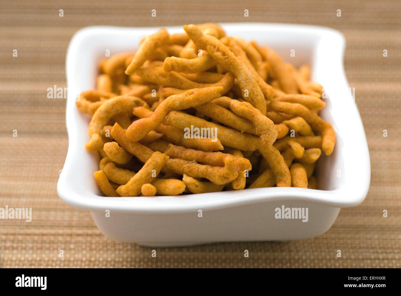 Snacks ; gram flour fried spicy sev in tray - Stock Image
