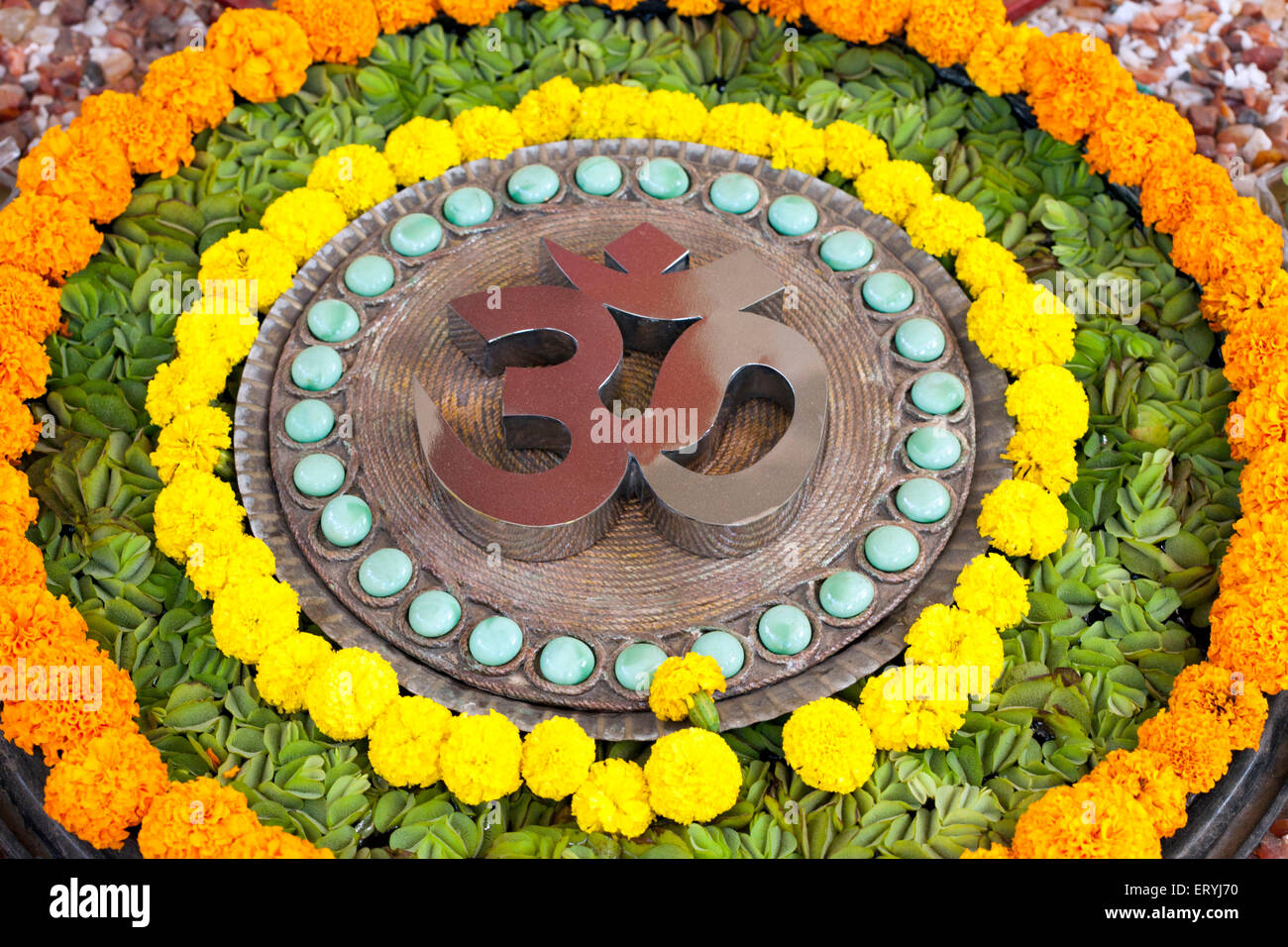 Om design pebbles flowers concentric circle India Asia - Stock Image