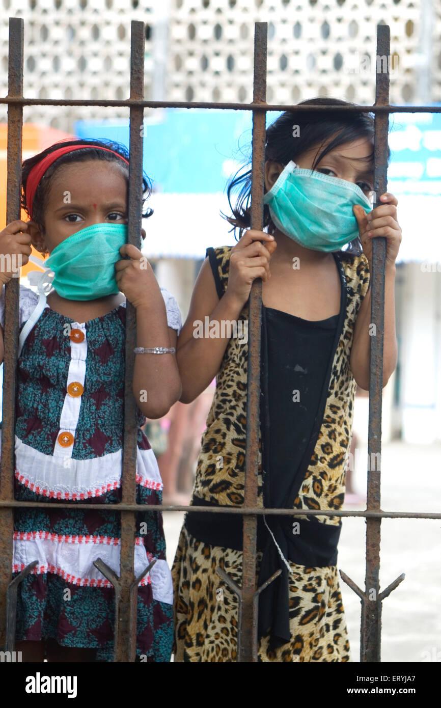 Girls wearing mask avoiding swine flu ; Bombay Mumbai ; Maharashtra ; India NO MR - Stock Image