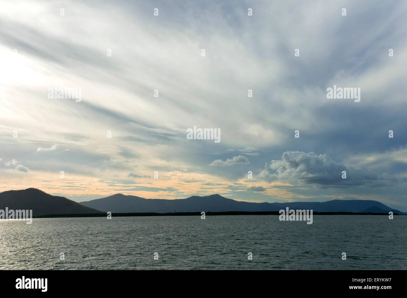 Cloudscape off harbour towards Green Island ; Cairns ; Queensland ; Australia - Stock Image