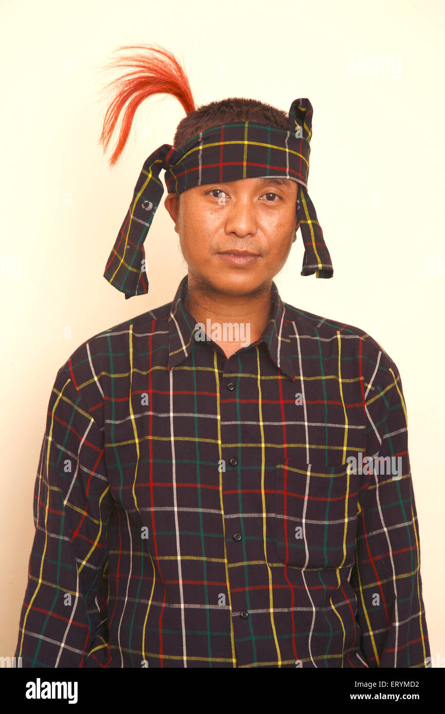 Mizo dancer in costume for Cheraw Dance of Mizoram ; India NO MR - Stock Image