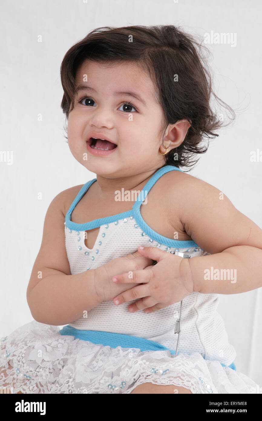 Fifteen month old baby girl both hands joined and kept on heart MR#743S - Stock Image